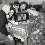 People gathered around a radio