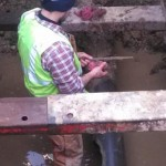 Madison worker repairs pipe.