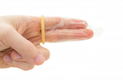 two finger in a condom