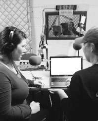 News Director Molly Stentz (left) and volunteer.