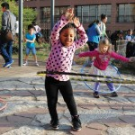 Photo of 2 young girls using hulahoop