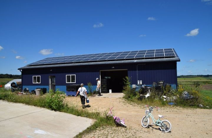 Packing shed with solar panels on top