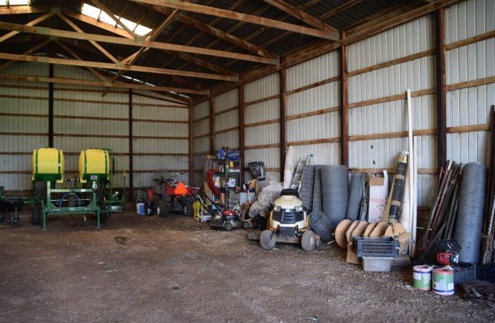 Transplanter and rows of fencing inside equipment shed