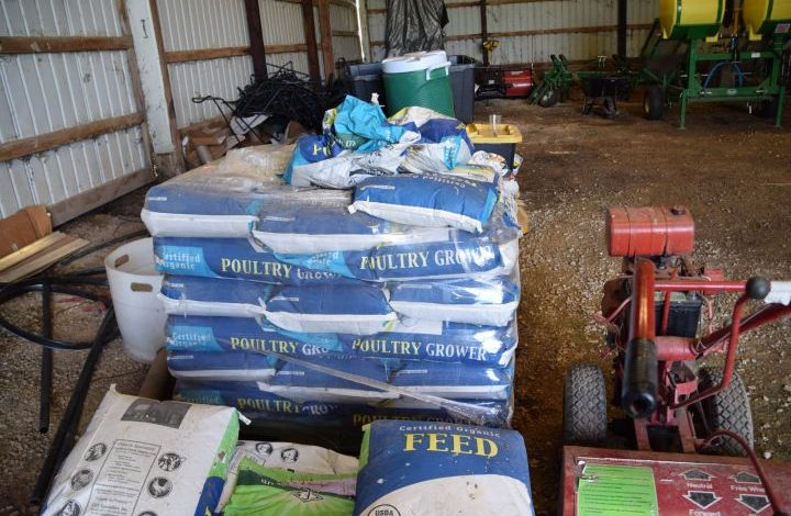 Stack of bags of organic chicken feed