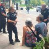 Photo of police officers talking with State Street occupants