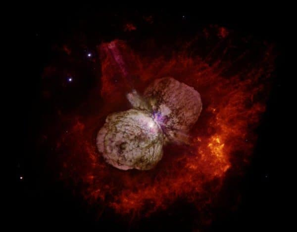 Best known for an enormous eruption in the 1840s that created the billowing, hourglass-shaped Homunculus nebula imaged here by the Hubble Space Telescope, Eta Carinae is the most massive and luminous star system within 10,000 light-years. Credit: Nathan Smith/UA and NASA