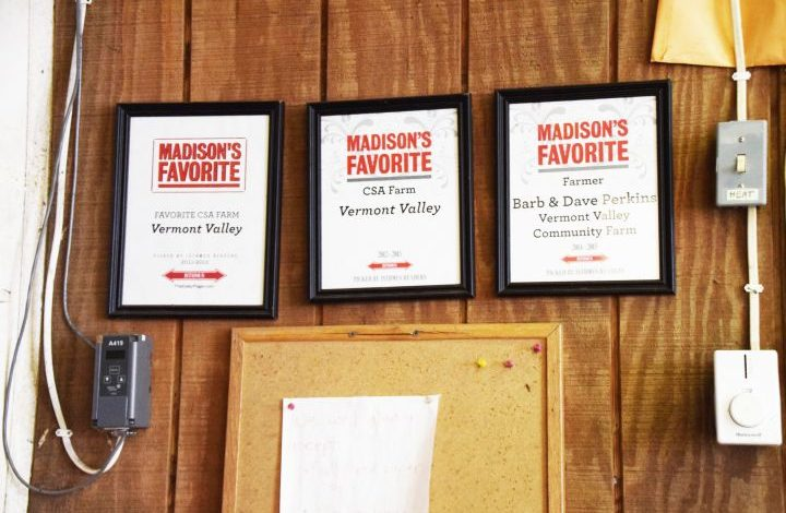 Madison Favorite framed certificates on a wall above a bulletin board