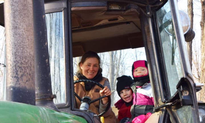 Farmer and kids inside tractor cab