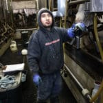 Photo of immigrant dairy worker by: Coburn Dukehart/Wisconsin Center for Investigative