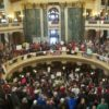 Photo of the WI Capitol Rotunda filled with protestors. Photo from dividedwefall-movie.com