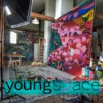 Photo from young-space.com of artist studio and a featured work of art.