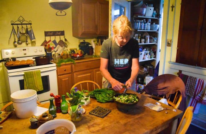 Dela preparing dinner